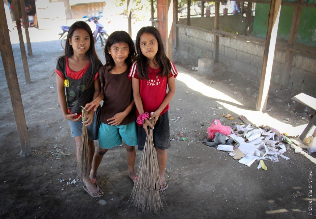 Girls cleaning up at a dumpsite in Liloan, Cebu, Philippines